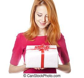 Red-haired girl in dress with present box