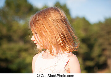 Red-haired girl in profile