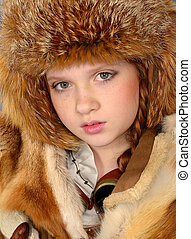 red-haired girl in winter clothes