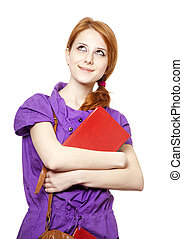 Red-haired girl keep book in hand. Studio shot.