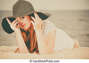 Red haired girl outdoor on beach