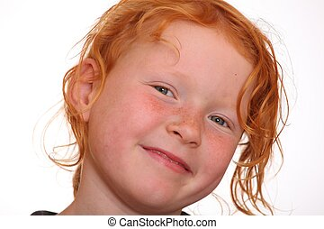 Portrait of a smiling red-haired girl