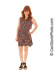 Red haired girl standing isolated over white background