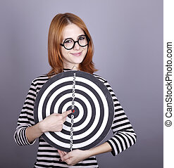Red-haired girl with dartboard.