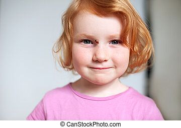 Red-haired girl with freckles
