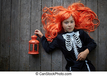Red-haired Halloween girl - Portrait of cute girl in red wig...