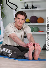 red-haired man doing stretching exercises