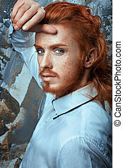 Red-haired man in white shirt metrosexual.
