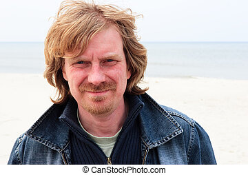 Red-haired man - Portrait of the red haired blue-eyed mature...