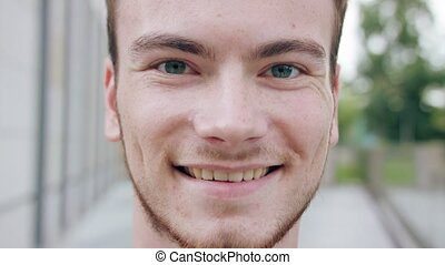 Red-Haired Man with Beard Smiling in Town - A young...