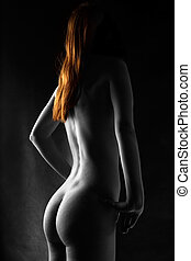 Red haired nude - Selectively colored nude with bright red...