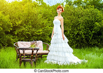 red-haired - Lovely elegant red-haired bride stands on the...