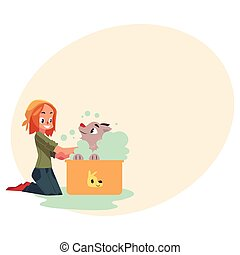 Red haired teenage girl washing, bathing her dog, puppy