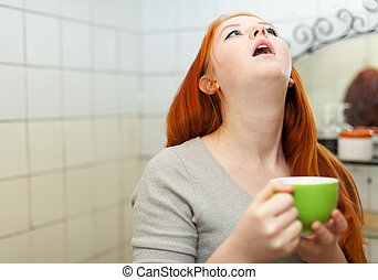 red-haired teenager gargling throat in bathroom - red-haired...