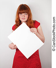 red-haired woman holding blank sign