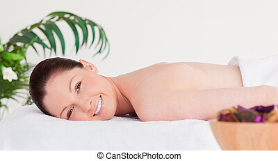 Red-haired woman in a spa