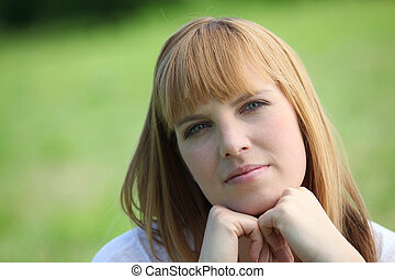 red-haired woman in green setting