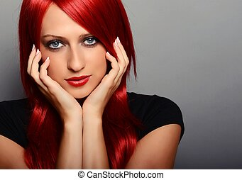 Red haired woman - Beautiful red haired woman over gray...