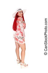 Red haired woman standing from back.
