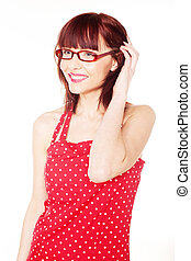 red haired woman wearing red dress with polka dots