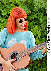 Red haired woman with a guitar