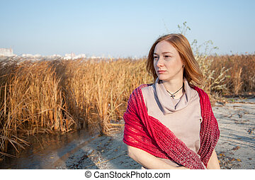 Red-haired woman with a red shawl