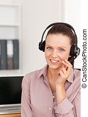 Red-haired woman with headset