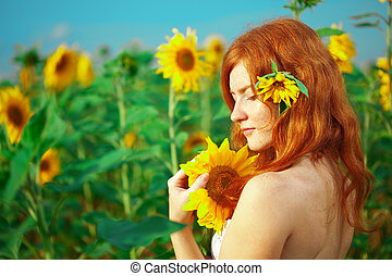Red-haired woman with sunflowers - Beautiful red-haired ...