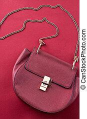 Red handbag vertical shot.