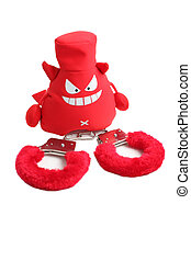Red handcuffs, evil toys devil isolated on white background