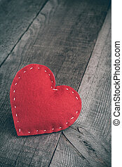 Red handmade heart on wooden table background with copy space. Valentines day. Matte and toned. Soft focus.