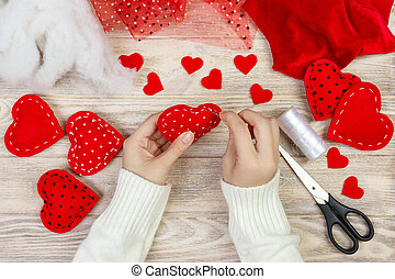 Red handmade heart-shaped soft toy, Valentine day, romantic relationship, healthy lifestyle, beautiful present, love and health care concept. holiday decorate valentine day