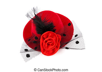 Red hat with black plume and rose on white background