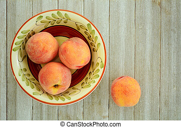 Red Haven peaches - Fresh organic red haven peaches on...