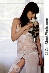 Red Head Caucasian Woman Standing In White Lingerie