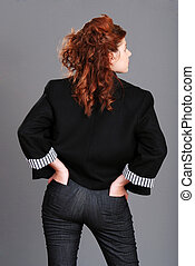 red head woman hands in back pocket