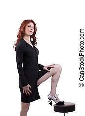 Red headed caucasian woman foot on stool