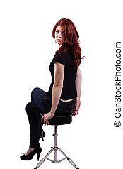 Red Headed Caucasian Woman Sitting On Stool