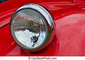 Red headlamp on classic car