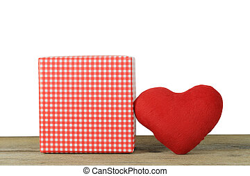 Red heart and Gift Box placed on a wooden floor on a white background.