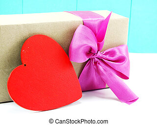 red heart and gift box with pink bow