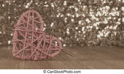 beautiful pink heart rattan heart on shiny background