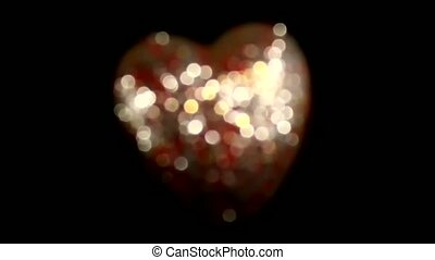 beautiful video with red shiny heart on black background