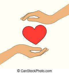 red heart between two hands