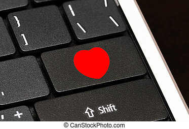 Red Heart button on computer keyboard. Internet dating concept
