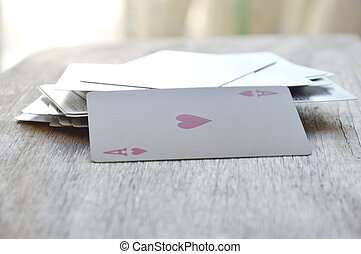 red heart card opened on wooden board