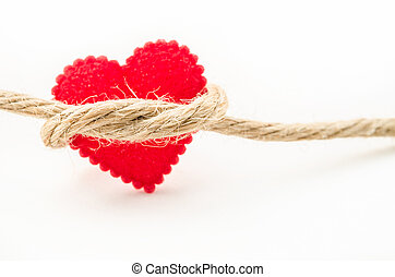 Red heart connected with a rope.