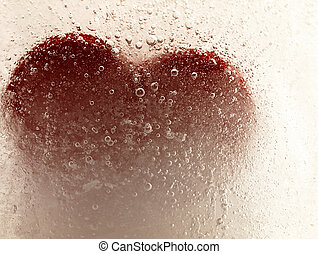 Red heart embedded in ice. - Ice cube with a heart in the ...