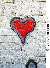 Red heart grafitti on a whitewashed brick wall