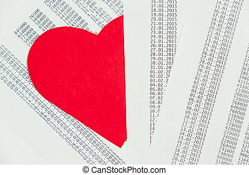 Red heart hidden among the papers